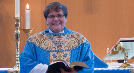 The Rev. Jamie Samilio conducts the Holy Eucharist