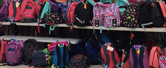 backpacks filled with items for foster children